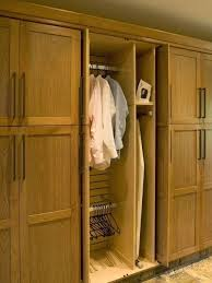 ironing board closet cabinet ironing board storage cabinet exle of a classic closet design in