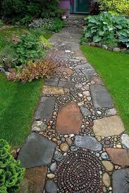 an abstract path of river stone mosaic swirls and flagstone lead