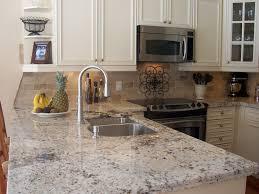 kitchen microwave chrome faucet granite countertops black stove