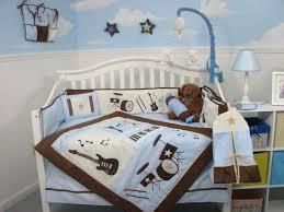 baby boy nursery furniture monkey doll on floor white wooden hutch
