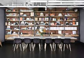 Whole Wall Bookshelves Industrial Loft With Exposed Brick Walls And Black Wood Digsdigs
