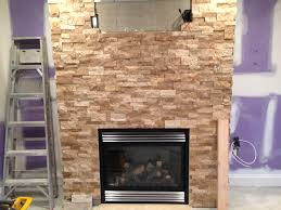 roman beige ledger stone accent wall and fireplace surround brown
