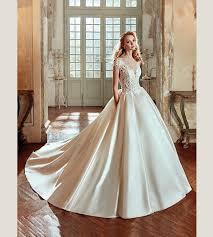 haute couture boat neck sheer bodice satin ballgown wedding dress
