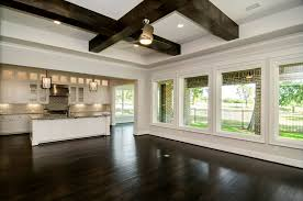 open floor plan with windows in back and windows in breakfast nook