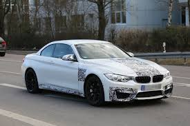 spyshots bmw m4 convertible spotted with red frozen paint