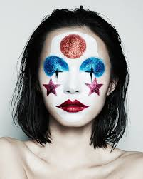 clown makeup red lips white face star circle glitter