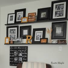 Rustic Maple Family Room Gallery Wall With Picture Ledges - Family room photo gallery