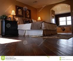 luxury bedroom with hardwood flooring royalty free stock photo