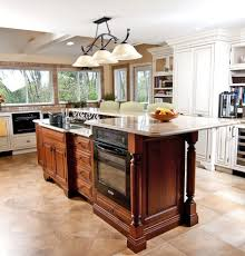 kitchen island with stove and oven also two level breakfast bar