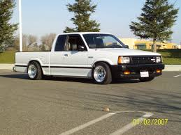stanced nissan hardbody i want one lol that is why i pinned this one ii wanna