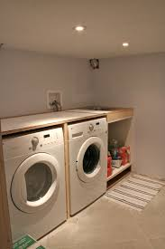 basement laundry room interiors ideas with double white washing