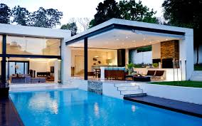 modern white nuance home plans over water that has warm lighting