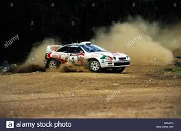 world auto toyota toyota rally car cornering on a dirt road during the telstra world