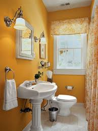 painting best yellow paint color with classic pedestal sink for