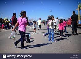 kids catching candies during morning parade at navajo nation fair