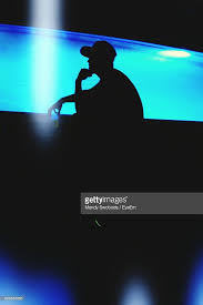 Pool At Night Silhouette Man Holding Beer Glass By Swimming Pool At Night Stock