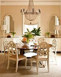 round table w leaves chandelier seagrass rug from mrs howard