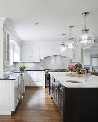 White Dove Benjamin Moore Kitchen Cabinets - white and black kitchen features white cabinets painted benjamin