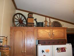 decorating above kitchen cabinets home design