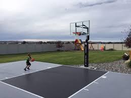 Backyard Basketball Court Ideas by This Is A Forest Green And Red Concrete Backyard Basketball Court