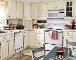 cream colored kitchen cabinets with white appliances kitchen