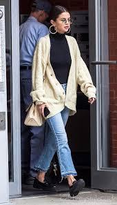 selena gomez is bringing back the grandpa sweater trend selena