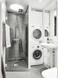 Laundry Stacked Washed  Dryer In Bathroom Next To Shower - Bathroom laundry designs