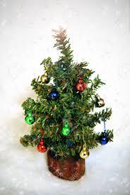 miniature tree with tiny ornaments amid