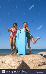 friends hamming it up at the beach paines beach cape cod