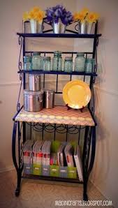 chrome kitchen rack accessorize with hooks to hang pans and