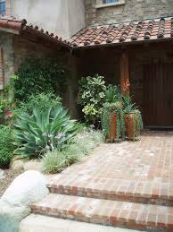wrought iron planters patio mediterranean with boulder landscape