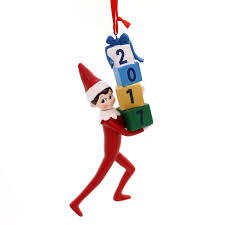 2017 department 56 on the shelf holding presents