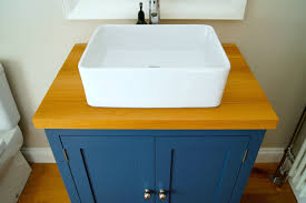 bespoke bathroom sink cabinets constructed from pure oak