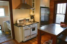 Rustic Kitchen Hoods - cottage kitchen with high ceiling by bkc kitchen u0026 bath zillow