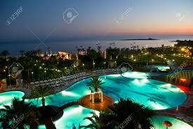 luxury hotel with pool at night stock photo picture and royalty