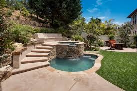 exterior design backyard jacuzzi with counter stools and wood