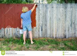 woman painting fence stock images image 26897944