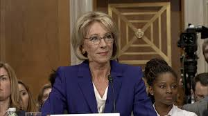 warren grills devos about protecting students from loan abuse