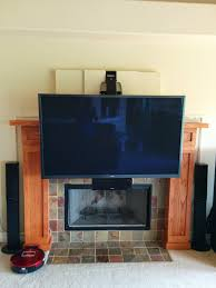 mounting tv over fireplace bristol ct tv above fireplace in new