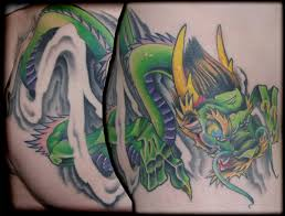 obscurities tattoos and piercings tattoos memphis dragon on hip