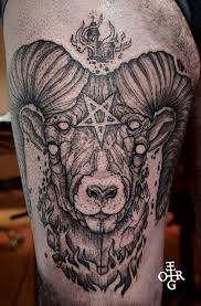 unique abstract goat head tattoo design for thigh