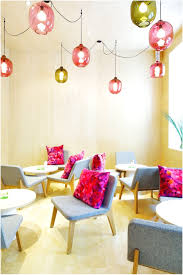 colorful kitchen table cafe with purple walls and has a nice white