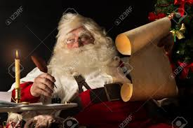 santa writing paper santa claus sitting at home and writing on old paper roll to santa claus sitting at home and writing on old paper roll to do list with quill