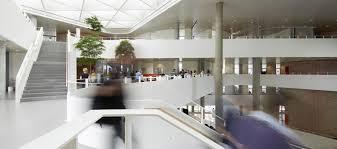 this building u0027s geometric facade transforms to regulate daylight