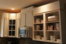 how to add trim to bottom of kitchen cabinets how to add height to your kitchen cabinets