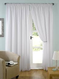pair of ready made white lined tape top voile curtains 45