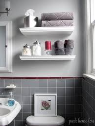 floating shelves for small bathroom with gray tile white walls and
