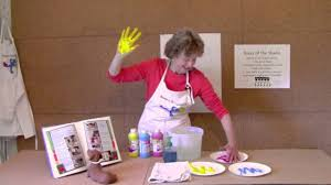color mixing with annie painter making a hand print color wheel