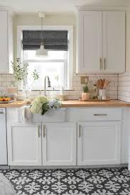 white kitchen cabinets black tile floor 40 black and white floor tile for your kitchen