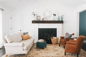 robust green garland as wells as mantel surround in living room